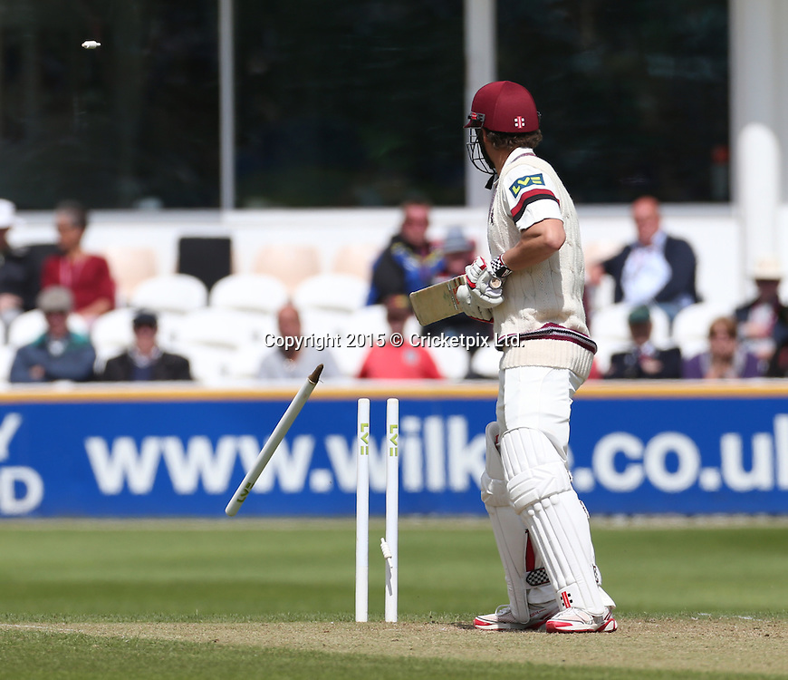 James Hildreth watches his leg stump fly after being bowled by Ben Wheeler during the four day game between Somerset and a New Zealand XI at the County Ground, Taunton. Photo: Graham Morris/www.cricketpix.com (Tel: +44 (0)20 8969 4192; Email: graham@cricketpix.com) 09052015