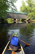 Canoeing Otter Creek past the West Salisbury covered bridge, Salisbury, Vermont.                          ..