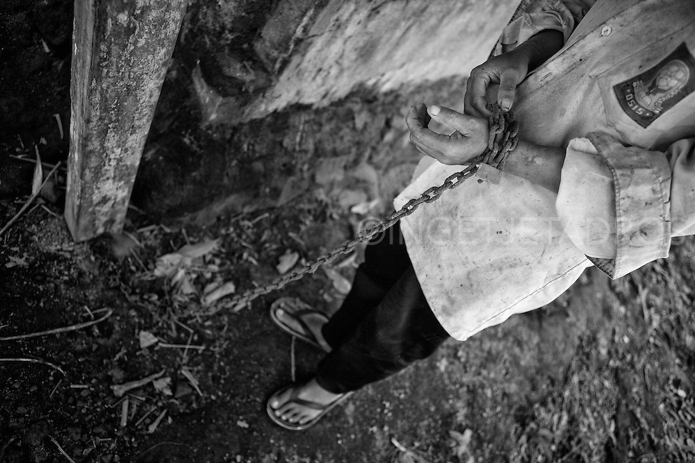 Nengah is not in Pasung anymore. She tells me that after hearing voices and seeing a hallucination of a handsome man she murdered her stepmother. Her punishment was to be handed back to her family as the Court deemed her mentally unfit to stand trial.<br /> The family put her in the pig stable in the backyard in  2002. After being found by Dr. Suryani in 2012 she received treatment and was released from Pasung and is now free and receives no more medicines. &copy;Ingetje Tadros/Diimex<br /> Publishing Rights www.diimex.com Bali,Indonesia