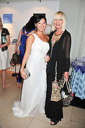 Left to right, BEATRIX ONG and VIRGINIA BATES at the English National Ballet Summer Party held at The Orangery, Kensington Palace, London on 27th June 2012.