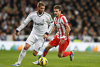01.12.2012 SPAIN -  La Liga 12/13 Matchday 14th  match played between Real Madrid CF vs  Atletico de Madrid (2-0) at Santiago Bernabeu stadium. The picture show Sergio Ramos (Spanish defender of Real Madrid) and Mario Suarez Mata (Spanish midfielder of At. Madrid)