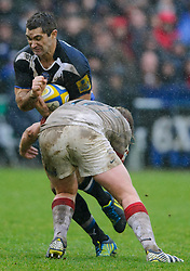 Bath Fly-Half (#10) Stephen Donald is tackled by Saracens replacement (#17) Rhys Gill during the second half of the match - Photo mandatory by-line: Rogan Thomson/JMP - Tel: Mobile: 07966 386802 22/12/2012 - SPORT - RUGBY - The Recreation Ground - Bath. Bath Rugby v Saracens - Aviva Premiership.