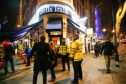 "© Licensed to London News Pictures. 24/02/2016. London, UK. Police at the scene of a ""hostage situation"" at Bella Italia restaurant in Leicester Square, London where a man claiming to be in possession of a knife is holding a woman against her will. Metropolitan Police reported the incident is not terrorist-related. Photo credit: Tolga Akmen/LNP"