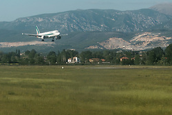 May 4, 2017 - Tirane, Albania - An Alitalia jet approaches for landing at Tirana International Airport in Albania. The Italian national airline is being put up for sale in bankruptcy proceedings for the second time in a decade. (Credit Image: © Nir Alon via ZUMA Wire)