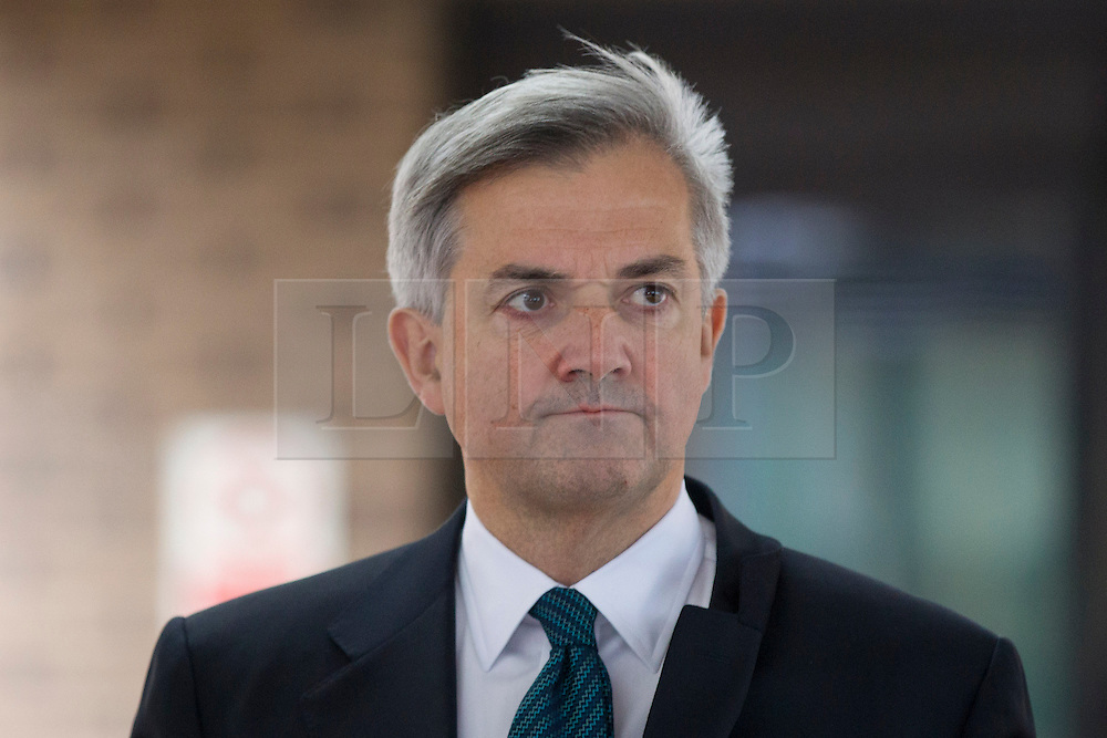 © Licensed to London News Pictures. 04/02/2013. London, UK. Former Cabinet minister Chris Huhne is seen leaving Southwark Crown Court in London today (04/02/2013) to deliver a statement, in which he announced his resignation as a member of parliament, to the media after pleading guilty to perverting the course of justice in conjunction with a 2003 speeding case. Photo credit: Matt Cetti-Roberts/LNP