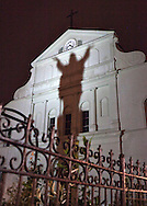 A statue casts a shadow outside the St. Louis Cathedral on Jackson Square in New Orleans, August 18, 2012