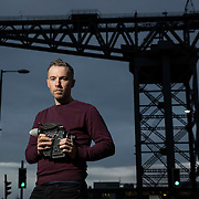Turner Prize winner 2014 Duncan Campbell by the Finnieston Crane in Glasgow.  Picture Robert Perry for The Times 15th Dec 2014<br /> <br /> Must credit photo to Robert Perry<br /> FEE PAYABLE FOR REPRO USE<br /> FEE PAYABLE FOR ALL INTERNET USE<br /> www.robertperry.co.uk<br /> NB -This image is not to be distributed without the prior consent of the copyright holder.<br /> in using this image you agree to abide by terms and conditions as stated in this caption.<br /> All monies payable to Robert Perry<br /> <br /> (PLEASE DO NOT REMOVE THIS CAPTION)<br /> This image is intended for Editorial use (e.g. news). Any commercial or promotional use requires additional clearance. <br /> Copyright 2014 All rights protected.<br /> first use only<br /> contact details<br /> Robert Perry     <br /> 07702 631 477<br /> robertperryphotos@gmail.com<br /> no internet usage without prior consent.         <br /> Robert Perry reserves the right to pursue unauthorised use of this image . If you violate my intellectual property you may be liable for  damages, loss of income, and profits you derive from the use of this image.