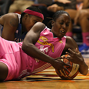 Ebony Hoffman, (right), Connecticut Sun, secures a loose ball during the Connecticut Sun Vs Minnesota Lynx, WNBA regular season game at Mohegan Sun Arena, Uncasville, Connecticut, USA. 27th July 2014. Photo Tim Clayton