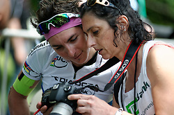 Manayunk Wall Bike Race Day, Philadelphia, PA USA - June 3 2012; World Champion and 2011 Liberty Classic winner Giorgia Bronzini looks at pictures on the back of the camera of photographer Lorenza Cerbini.<br /> <br /> Scenes from the 2011-2014 Philadelphia International Bicyling Classic #ManayunkWall Bike Race, traditionally held in the first week of June. (photo by Bastiaan Slabbers/BasSlabbers.com)<br /> <br /> For license options of Philadelphia International Cycling Classic related imagery please visit my editoiral stock portfolio at Getty Images/iStock.com: istockphoto.com/portfolio/basslabbers