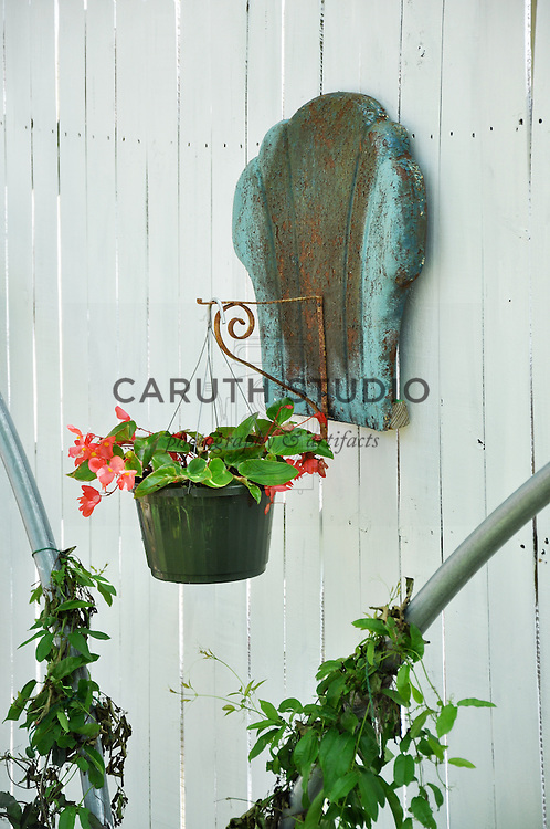 Vintage garden: Plant hanger made from old metal motel chair back and bracket