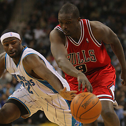 Jan 29, 2010; New Orleans, LA, USA; New Orleans Hornets forward Julian Wright (32) reaches in to knock the ball away from Chicago Bulls forward Luol Deng (9) during the first half at the New Orleans Arena. Mandatory Credit: Derick E. Hingle-US PRESSWIRE