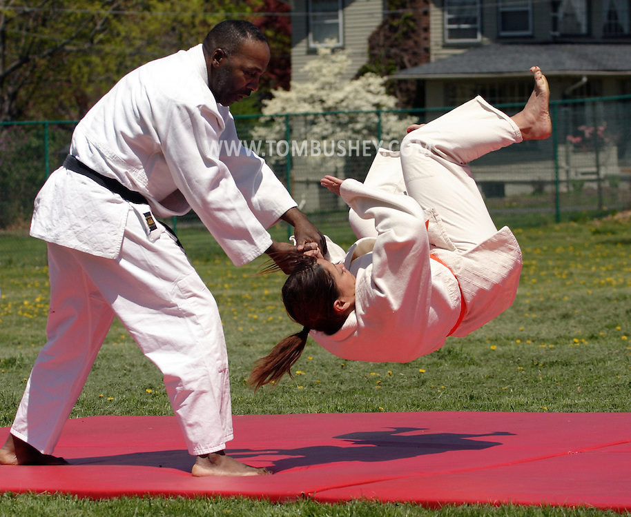 Middletown, N.Y. - Martial artists from the Orange County Budokan demonstrate Jujutsu moves during a festival behind the Middletown YMCA on April 29, 2006.