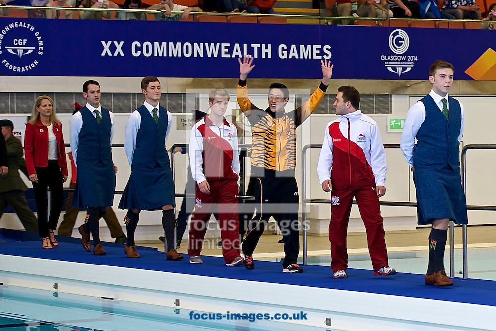 The medalists from the Men's 3 Metre Springboard competition (L-R Jack Laugher of England, Ooi Tze Liang of Malaysia and Oliver Dingley of England) prepare for the medal ceremony pictured during Diving Day Two at Royal Commonwealth Pool during Glasgow 2014 Commonwealth Games <br /> Picture by Ian Wadkins/Focus Images Ltd +44 7877 568959<br /> 31/07/2014