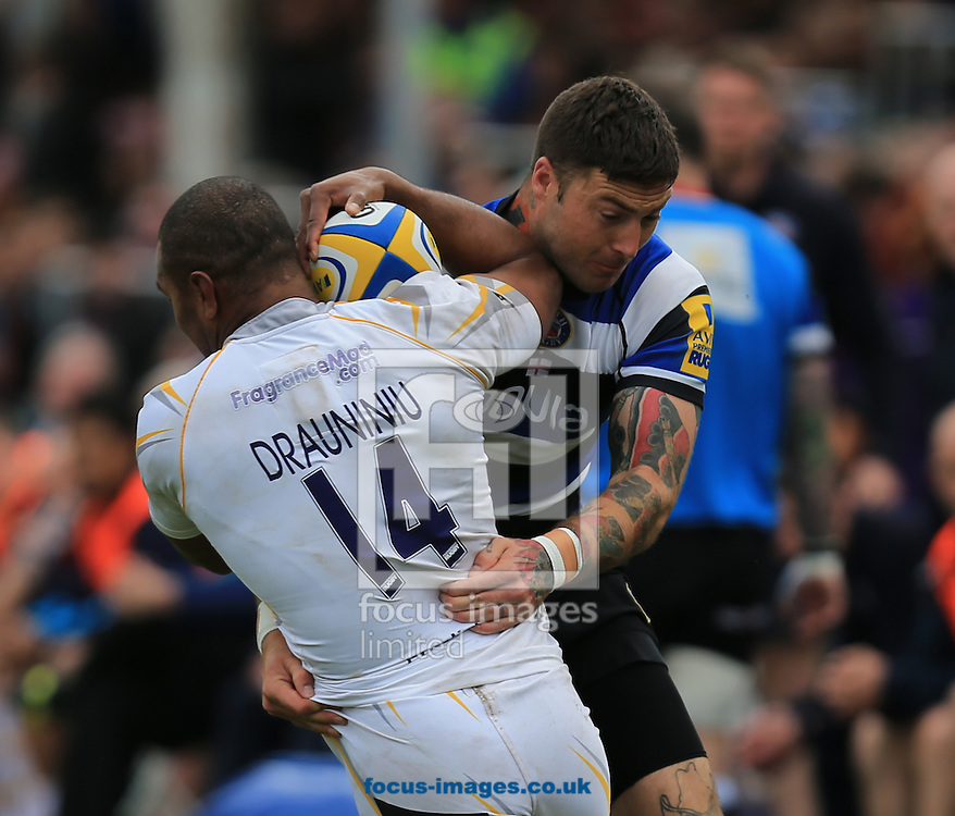 Matt Banahan of Bath Rugby and Josh Drauniniu of Worcester Warriors during the Aviva Premiership match at the Recreation Ground, Bath<br /> Picture by Michael Whitefoot/Focus Images Ltd 07969 898192<br /> 19/04/2014