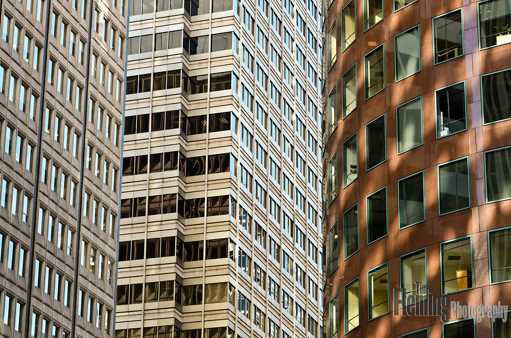 Late afternoon reflections in the office buildings on Market Street in San Francisco, California
