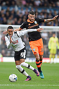 Derby County midfielder Tom Ince (10) battles with Sheffield Wednesday midfielder David Jones (3) during the EFL Sky Bet Championship match between Derby County and Sheffield Wednesday at the iPro Stadium, Derby, England on 29 October 2016. Photo by Jon Hobley.
