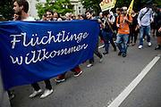 Frankfurt am Main | 05 July 2014<br /> <br /> Am Samstag (05.07.2014) demonstrierten in Frankfurt am Main etwa 250 Menschen aus der linksradikalen Szene gegen die deutsche Fl&uuml;chtlingspolitik, gegen Abschiebungen und f&uuml;r das Bleiberecht gefl&uuml;chteter Menschen in Deutschland und anderswo.<br /> Hier: Die Demo in der Bockenheimer Landstrasse, Transparent &quot;Fl&uuml;chtlinge willkommen&quot;.<br /> <br /> [Foto honorarpflichtig, kein Model Release]<br /> <br /> &copy;peter-juelich.com