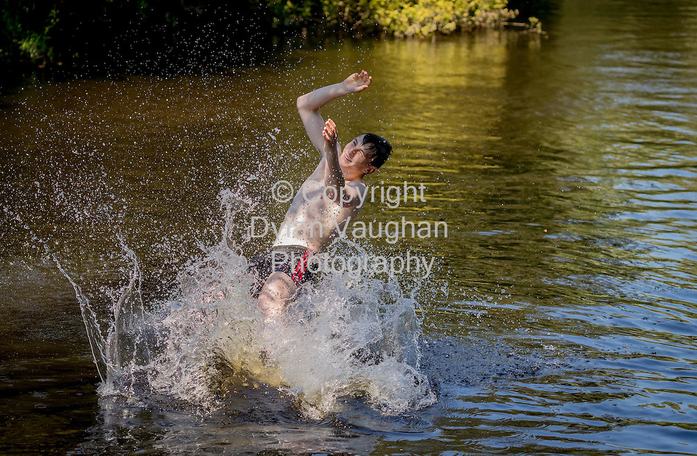 19-7-16<br /> <br /> James Bergin from Clara Co. Kilkenny pictured jumping into the River Nore on bleach Road in Kilkenny yesterday.<br /> Picture Dylan Vaughan
