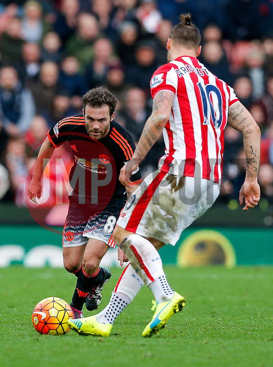 Juan Mata of Manchester United tackles Marko Arnautovic of Stoke City - Mandatory byline: Rogan Thomson/JMP - 26/12/2015 - FOOTBALL - Britannia Stadium - Stoke, England - Stoke City v Manchester United - Barclays Premier League - Boxing Day Fixture.
