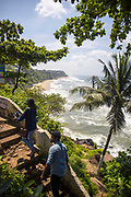 VARKALA, INDIA - 28th September 2019 - Tourists walking and enjoying the views at Varkala Cliff Beach , Kerala, Southern India