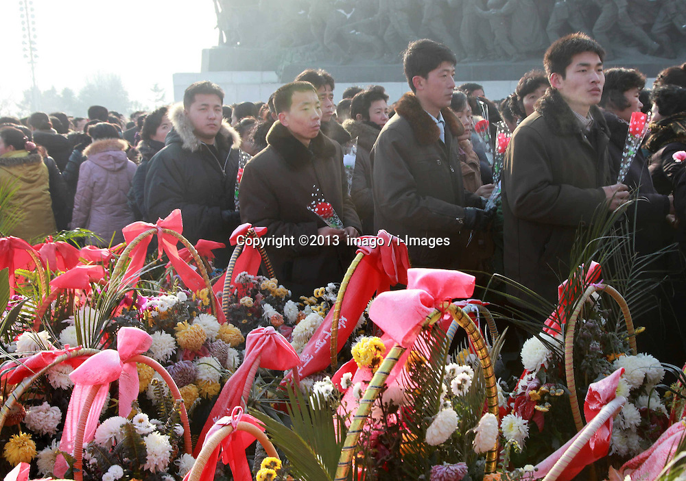 60833521 <br /> People pay tribute to the bronze statues of late top leaders Kim Il Sung and Kim Jong Il in Pyongyang, capital of the Democratic Peoples Republic of Korea (DPRK), Dec. 16, 2013. People gathered here on Monday to commemorate late leader Kim Jong Il for the second anniversary of his death which falls on Dec. 17. Monday, 16th December 2013. Picture by  imago / i-Images<br /> UK ONLY
