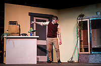 "Riley Alward as Seymour gives ""Audrey II"" a few drops of blood from his pricked finger during dress rehearsal for Little Shop of Horrors at Gilford High School on Tuesday afternoon.  (Karen Bobotas/for the Laconia Daily Sun)"