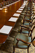 The long meeting table in the Locarno Room at the Foreign and Commonwealth Office (FCO), on 17th September 2017, in Whitehall, London, England. In 1925 the Foreign Office played host to the signing of the Locarno Treaties, aimed at reducing tension in Europe. The ceremony took place in a suite of rooms that had been designed for banqueting, which subsequently became known as the Locarno Suite. During the Second World War, the Locarno Suite's fine furnishings were removed or covered up, and it became home to a foreign office code-breaking department.