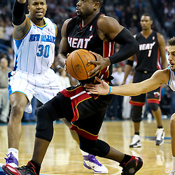 November 5, 2010; New Orleans, LA, USA; Miami Heat shooting guard Dwyane Wade (3) drives past New Orleans Hornets power forward David West (30) during the first quarter at the New Orleans Arena. Mandatory Credit: Derick E. Hingle