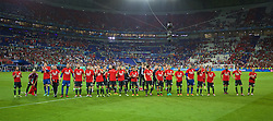LYON, FRANCE - Wednesday, July 6, 2016: Wales' Gareth Bale and his team wear shirt with 'Diolch' on [Thank-you in Welsh] as they salute their supporters after the 2-0 defeat to Portugal during the UEFA Euro 2016 Championship Semi-Final match at the Stade de Lyon. Joe Allen, Aaron Ramsey, goalkeeper Wayne Hennessey, Ben Davies, goalkeeper Daniel Ward, Sam Vokes, Simon Church, Andy King, captain Ashley Williams, Hal Robson-Kanu, Neil Taylor, Gareth Bale, David Cotterill, David Edwards, Ashley 'Jazz' Richards, goalkeeper Owain Fon Williams, David Vaughan, George Williams, James Collins, Joe Ledley, Chris Gunter, Jonathan Williams. (Pic by David Rawcliffe/Propaganda)