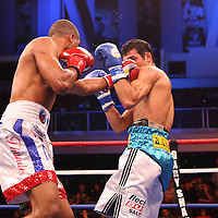 Luis Carlos Abregu (right) and Thomas Dulorme fight for the WBC International title during the HBO Triple Explosion fight at the Turning Stone Resort Casino in Verona, NY, on Saturday, Oct 27, 2012.  Abregu won the bout by TKO in the 7th round.(AP Photo/Alex Menendez)