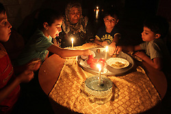 28.07.2015, Rafah, PSE, Stromausfall in Rafah, im Bild Palästinenser im Kerzenschein während einen Stromausfall // Palestinian family use a candle light as they eat dinner during a power cut. Independent Commission for Human Rights warned Saturday of the aggravated humanitarian situation in Gaza due to continued electricity outage after the Gaza's sole power plant stopped running, which make problems with water supply because many of the area's water pumps also rely on that power plant, Palestine on 2015/07/28. EXPA Pictures © 2015, PhotoCredit: EXPA/ APAimages/ Abed Rahim Khatib<br /> <br /> *****ATTENTION - for AUT, GER, SUI, ITA, POL, CRO, SRB only*****