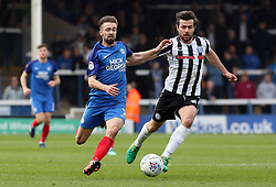 Gwion Edwards of Peterborough United in action with Joe Rafferty of Rochdale - Mandatory by-line: Joe Dent/JMP - 14/04/2018 - FOOTBALL - ABAX Stadium - Peterborough, England - Peterborough United v Rochdale - Sky Bet League One