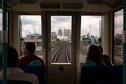 © Licensed to London News Pictures. 23/08/2012, London, UK.  Passengers look out through the front as they travel on a DLR train in east London, Thursday, Aug. 23, 2012. DLR, Docklands Light Railway, is celebrates its 25th annivesary today. Photo credit : Sang Tan/LNP