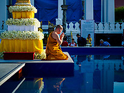 "03 NOVEMBER 2017 - BANGKOK, THAILAND: A monk at Wat Prayurawongsawat on the Thonburi side of the Chao Phraya River, prays during Loi Krathong. Loi Krathong is translated as ""to float (Loi) a basket (Krathong)"", and comes from the tradition of making krathong or buoyant, decorated baskets, which are then floated on a river to make merit. On the night of the full moon of the 12th lunar month (usually November), Thais launch their krathong on a river, canal or a pond, making a wish as they do so. Loi Krathong is also celebrated in other Theravada Buddhist countries like Myanmar, where it is called the Tazaungdaing Festival, and Cambodia, where it is called Bon Om Tuk.     PHOTO BY JACK KURTZ"