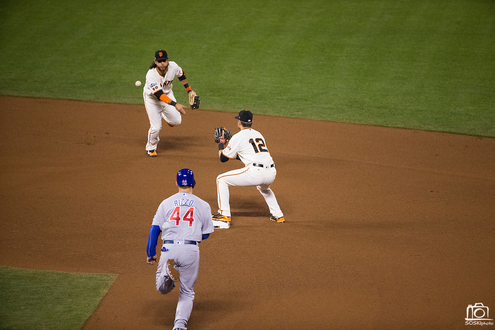 San Francisco Giants shortstop Brandon Crawford (35) flips a fielded ground to second baseman Joe Panik (12) for a double play against the Chicago Cubs during Game 4 of the NLDS at AT&T Park in San Francisco, Calif., on October 11, 2016. (Stan Olszewski/Special to S.F. Examiner)