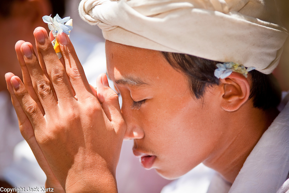 """Apr. 22 - UBUD, BALI, INDONESIA: Hindus in Bali pray during an Odalan ceremony in a family temple in Ubud, Bali, Indonesia. The Odalan ceremony is the """"birthday"""" ceremony for Hindu temples in Bali and are held every 210 days. They are common in Bali.   Photo by Jack Kurtz/ZUMA Press."""