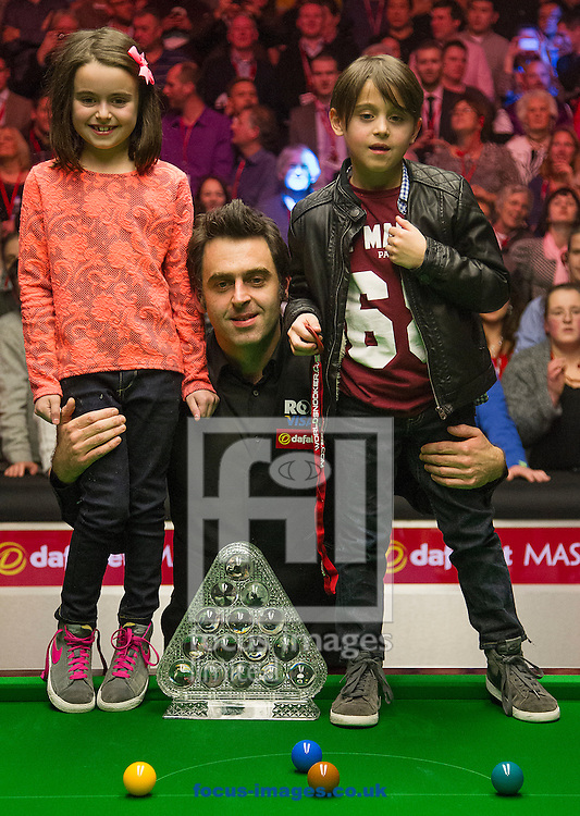 Picture by Paul Terry/Focus Images Ltd +44 7545 642257<br /> 19/01/2014<br /> Ronnie O'Sullivan with his Daughter Lily and Son Ronnie Jnr after winning The Masters final at Alexandra Palace, London.