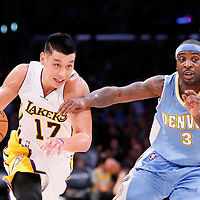23 November 2014: Los Angeles Lakers guard Jeremy Lin (17) drives past Denver Nuggets guard Ty Lawson (3) during the Los Angeles Lakers season game versus the Denver Nuggets, at the Staples Center, Los Angeles, California, USA.