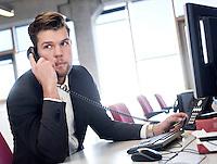 Foto: David Rozing Nederland Amsterdam 19-04-2014 20140419 Model released Model release aanwezig. Man doet belangrijk telefoontje, eigen onderneming starten in nieuw leeg bedrijfspand, de bank bellen,  telefonisch overleg, crisis, crisisberaad, erop of eronder, hekele situatie, spannend gesprek, uitslag vernemen, update krijgen, managen, manager, irritatie, management.n David Rozing; Inkomen; Vakmanschap; activiteit; afgeronde studie; afgestudeerde; afgestudeerden; ambitieuze; ambitite; ambititeus; analyseren; arbeid; arbeidsmarkt; arbeidzaam; arbeidzame; arbo regels; arbo wetgeving; arboregels; baan; baanzekerheid; banen; bedrijf; bedrijf starten; bedrijfscultuur; bedrijfsleven; bedrijvigheid; beheersgerichte cultuur; belabgen; belangrijk gesprek; belangrijk telefoongesprek; belletje maken; bereikbaar; bereikbaarheid; beroep; beroepen; beroepsgroep; besluitvaardigheid; besturen; bestuursfunctie; breinwerker; bureaubaan; bureauwerk; business; business meeting; career; carriere; carriere mogelijkheden; carrierestappen; carrièreverloop; collega; collega's; communicatie; communicatie technologie.; communicatiemiddel; communicatiemiddelen; communicatieve vaardigheden; communiceren; concentratie; conversatie; converseren; craftmanship; creatieve; creatieve oplossingen; creativiteit; de ander een handje helpen; de handen armen uit de mouwen steken; de kost verdien; de mouwen opstropen; denken; discipline; doelen; doelstellingen; dutch; efficiency; efficient werken; employee; employees; ervaring opdoen; excelleren; experimenteren; financieel plan; financiele planning; financiele zekerheid; flexibel; flexibiliteit; formeel; formeel gekleed; formele; geconcentreerd; gedisciplineerd; gedisciplineerde; gedreven; gedrevenheid; geld verdienen; generatie Y; genieten; gespannen situatie; gesprek; goal; goed betaald; goed betaalde; goede werklust; grenzeloze generatie; groei; groeien; groot talent; grote belangen; grote verantwoordelijheid; heer; heertje; heertjes; heren;