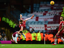 Nathan Baker of Bristol City battles for the high ball with  Robert Snodgrass of Aston Villa  - Mandatory by-line: Joe Meredith/JMP - 01/01/2018 - FOOTBALL - Villa Park - Birmingham, England - Aston Villa v Bristol City - Sky Bet Championship
