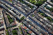 """Nederland, Amsterdam, De Pijp, 12-05-2009; Albert Cuypstraat met marktkramen in stadsdeel Oud-Zuid, diagonaal van Ferdinand Bolstraat naar de Van Woustraat (linksboven, net buiten beeld)..De straat wordt doorsneden door de Eerste van der Helststraat die loopt langs het Sarphatipark en uitkomt op het Gerard Douplein. De Albert Cuypmarkt is een dagmarkt, in de volksmond de """"Cuyp"""". Air view on the most famous daily market of Amsterdam, the Albert Cuyp market..Swart collectie, luchtfoto (toeslag); Swart Collection, aerial photo (additional fee required).foto Siebe Swart / photo Siebe Swart"""