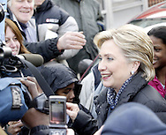 """Hillary Clinton shakes hands and talks to a small crowd across the street from the Fair River Oaks Council (FROC) office in Dayton, February 14, 2008.  Clinton was attending a """"Roundtable Discussion On Home Foreclosure Crisis."""""""