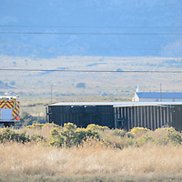 A tractor trailer rests on its side at the 7-mile-marker of Interstate 40 near Manuelito Friday.