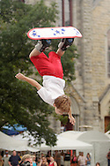 Goshen, NY - A young member of the Skyriders, an acrobatic trampoline team, jumps high into the air on a snowboard at the Great American Weekend festival on July 5, 2008.
