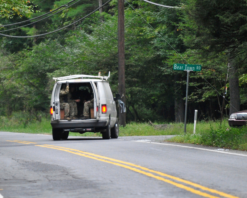 Police surround a neighborhood in the Pocono Mountains in search of ambush suspect Eric Matthew Frein who is accused of shooting two Pennsylvania State Troopers Saturday Sept. 20th, 2014 in Canadensis, Pennsylvania (AP Photo/Chris Post)