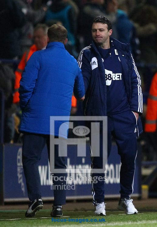 Picture by John Rainford/Focus Images Ltd +44 7506 538356.02/04/2013.Managers Dougoe Freedman of Bolton Wanderers and Mark Robins of Huddersfield Town shake hands after the final whistle in the npower Championship match at the Reebok Stadium, Bolton.
