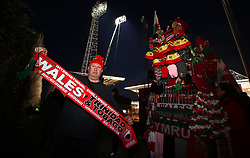 A Wales fan shows his support outside the grounds prior to the International Friendly match at the Racecourse Ground, Wrexham.