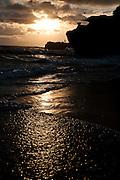 Sunset at black sand beach near Alila Villas Soori, Bali