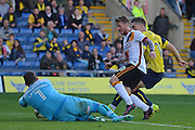 Oxford United goalkeeper Simon Eastwood (1) gathers the ball ahead of Bradford City striker Billy Clarke (10) 0-0 during the EFL Sky Bet League 1 match between Oxford United and Bradford City at the Kassam Stadium, Oxford, England on 15 October 2016. Photo by Alan Franklin.