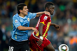 Maximiliano Pereira of Uruguay vs Sulley Muntari of Ghana during to the 2010 FIFA World Cup South Africa Quarter Finals football match between Uruguay and Ghana on July 02, 2010 at Soccer City Stadium in Sowetto, suburb of Johannesburg. (Photo by Vid Ponikvar / Sportida)
